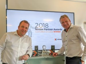 Synergi CTO Justin Short (left) and Peter Joynson celebrate winning a third Nintex Award