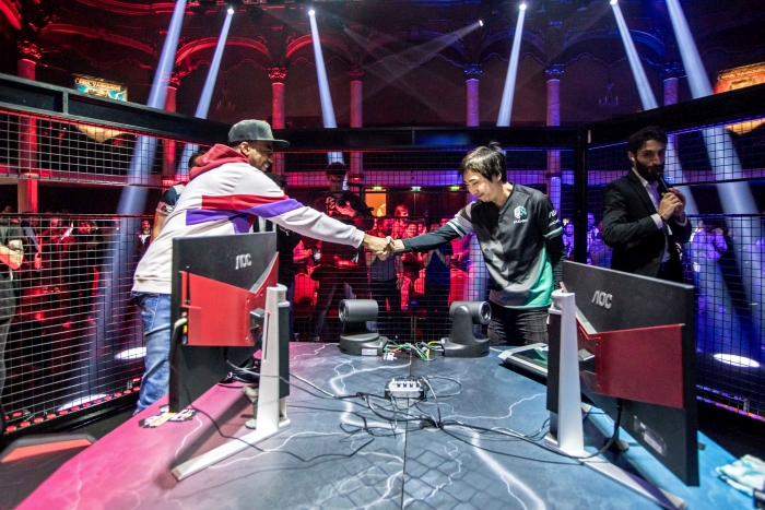 EVO Champion Problem X shakes hands with Red Bull Kumite 2018 champion Fujimura in Paris, France on November 11th 2018
