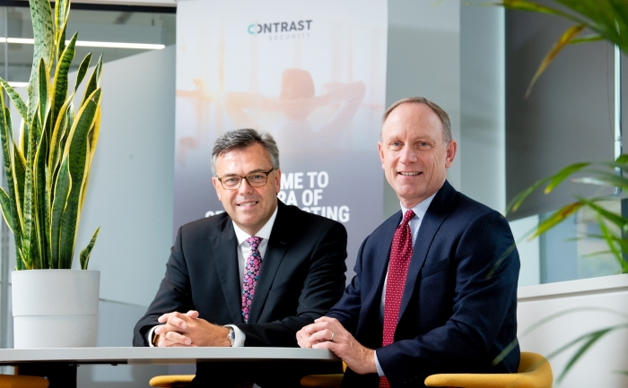 (L-R) Alastair Hamilton, CEO, Invest Northern Ireland and Alan Naumann, CEO, Contrast Security discussing the deal.